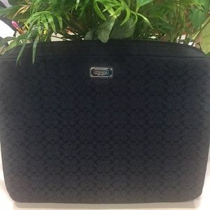 Coach laptop case.